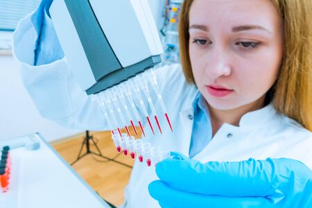 Girl lab technician at the clinic's microbiology laboratory 写真素材 - 129982463