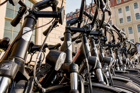 DRESDEN JUNE 2018. Docked bikes Row of bikes available to sell or rent Editorial