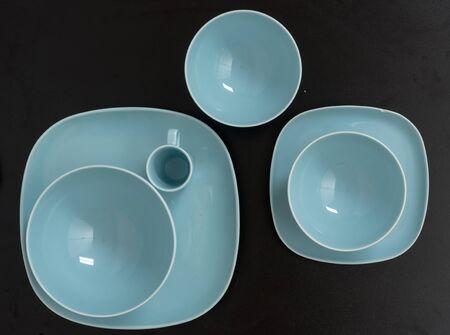Blue empty plates on black table Stock fotó - 130682519