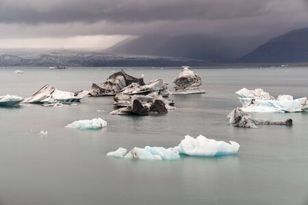 Fragments of iceberg in sea water. Iceland north sea