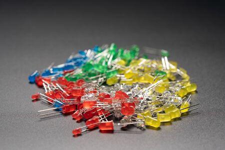 Set of colored LED light-emitting diode (LED) on background Фото со стока