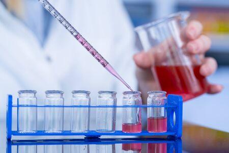 Using  pipette in the laboratory