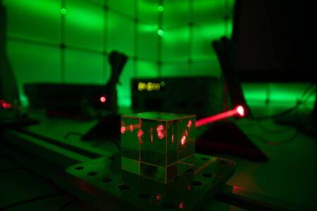 laser beam in optical laboratory