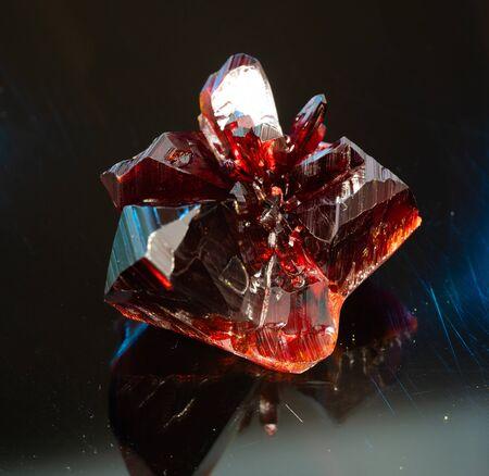 Natural raw red crystal. Natural red precious mineral stone
