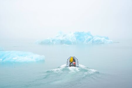 scientists on the boat study the melting of icebergs due to global warming
