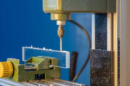 CNC  milling machine processes glass