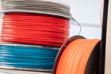 3D Printer Plastic filament for 3D printer and printed products in the interior of the design office 版權商用圖片