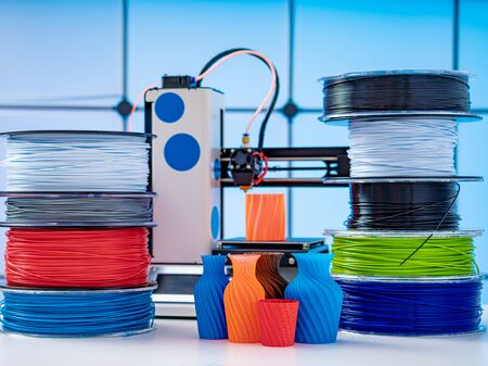 3D Printer Plastic filament for 3D printer and printed products in the interior of the design office Stock Photo