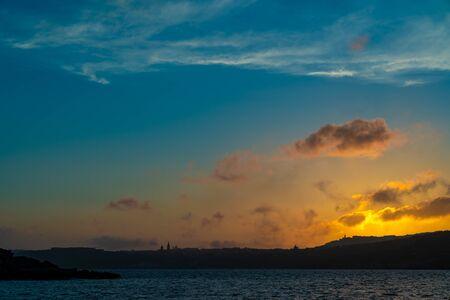 Sunset over mediterranean sea Beautiful cloudscape over the sea, sunrise  sunset shot.