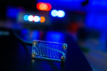 microfluidic device Instrument that uses micro amounts of fluid on a microchip to do certain laboratory tests.