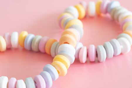 Sweets Beads and bracelets candy on  pink
