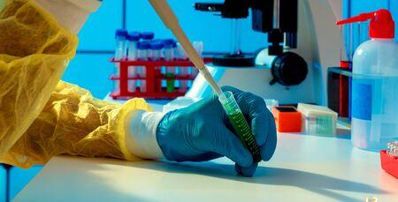 scientific experiment in microbiology laboratory. pipetting genetic materials Foto de archivo