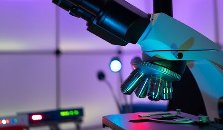 laboratory microscope in bokeh light