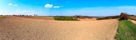 Panorama of spring plowed field 스톡 콘텐츠