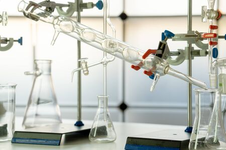 Glass instruments in the laboratory of chemical synthesis Stock Photo