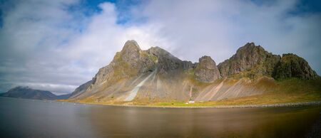 Panorama of the sea and mountains, a typical landscape in Iceland.