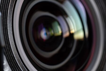 Close-up camera lens with color reflections