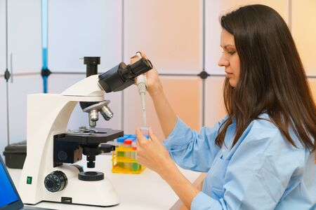 Young woman in a science lab. Health care researchers working in life science laboratory.