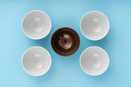 dinnerware, plates bowls on lilac table, top view,  flat lay
