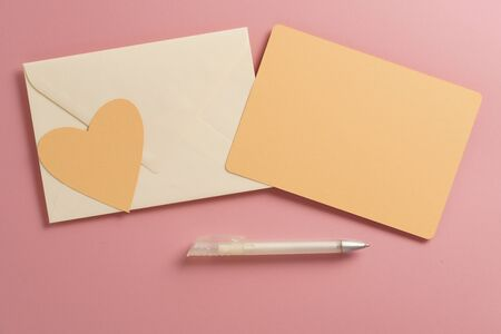 Flat lay mockup greeting card with pen and envelope