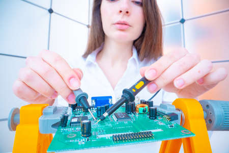 Young woman with measuring devices in the electronics engineer laboratory