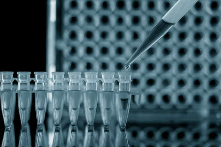 PCR Tube Strips Well and Pipette in genetic research laboratory close up 写真素材 - 154993857