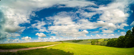 Wide Panorama Landscape in Germany in the Summer with blue sky and sun shine. 写真素材 - 154993866