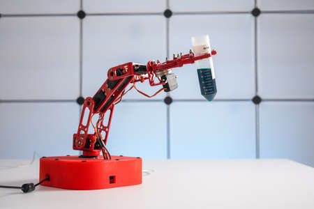 Robot arm with test tube with biological sample in science laboratory 写真素材 - 154993881