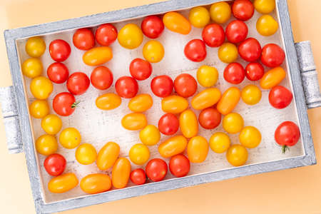 fresh italian cherry tomatoes on the vine in a wooden crate on a background 写真素材 - 154993922