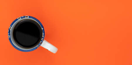 Top view, flat lay of black coffee cup on background orange 写真素材 - 154994350