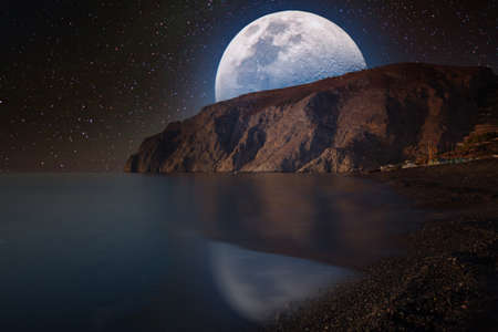 Fantastic landscape with a giant moon against the backdrop of a seascape 写真素材 - 154885701