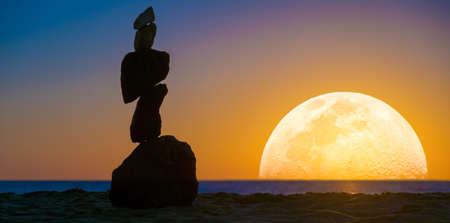 Zen stones pyramid on the background of the big moon and the sea 写真素材 - 154887140