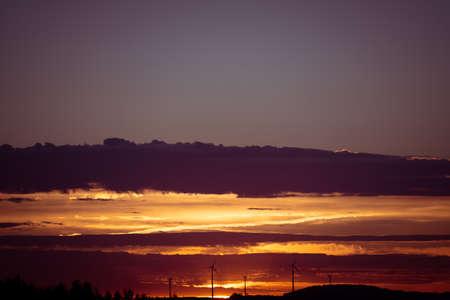 Wind turbines on a background of orange sunset sky