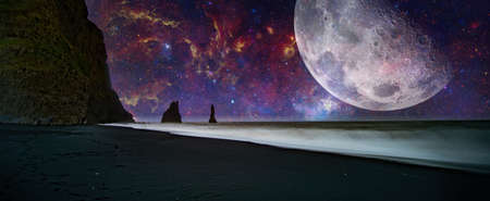 Fantastic landscape with a giant moon against the backdrop of a seascape. The elements of this image furnished by NASA.