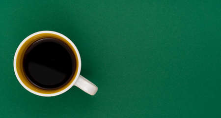 Top view, flat lay of black coffee cup on background green 写真素材 - 154886247