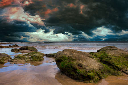 Stones and cloudy dramatic sky in sea 写真素材 - 154994812