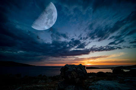 Fantastic landscape with a giant moon against the backdrop of a seascape 写真素材 - 154886495