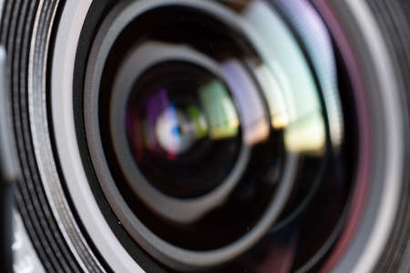 Close-up camera lens with color reflections 写真素材