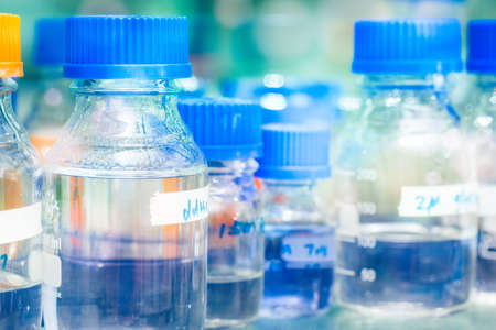 Rows of liquid chemicals in bottles at chemistry 写真素材