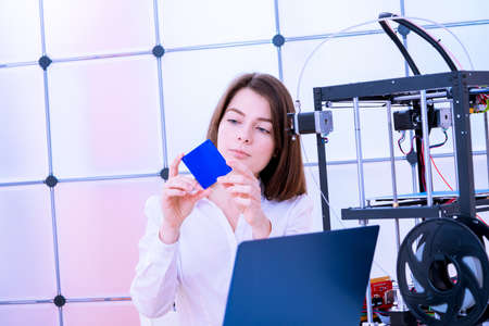 Young women designer in 3d printing lab 写真素材