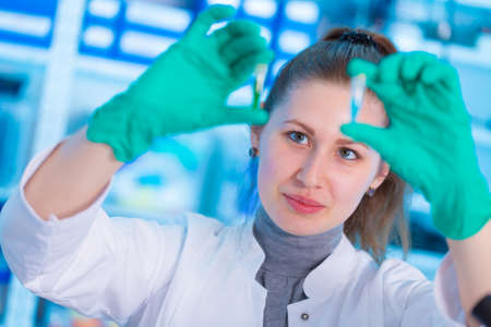 Young female laboratory assistant in laboratory analyzing environmental pollution