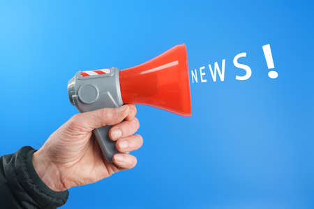 megaphone in hand and news concept