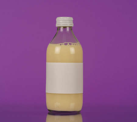 Small glass bottle with plant milk High quality photo