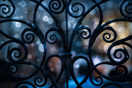 Forged metal grille with bokeh effect. Фото со стока