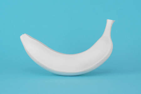 White banana on a blue background. Fake GMO product concept