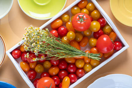 Ripe cherry tomatoes in a wooden box