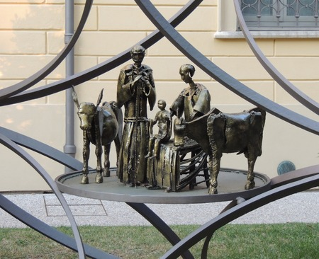 metal sculpture: bronze metal sculpture depicting a nativity scene with nativity, the donkey and the ox