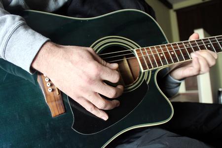 street musician: Man playing guitar spanish