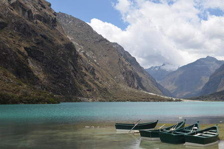 ancash: Boats in the peaceful Lake Chinancocha, District of Yungay, Ancash, Peru Stock Photo