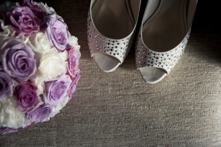 detail of shoes and bridal bouquet Stock Photo